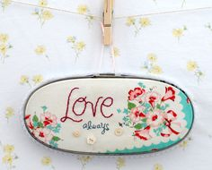 embroidered vintage hankie wall art- I love hankies. They remind me of my mom, my grandma, and when I was a little girl!