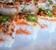 """Can't stop thinking about the """"Green Halo"""" @bigcatchcalgary with Aburi salmon thin sliced onions and jalapeño. Wishing they'd be open on a Monday as I'm already in need of another fix. #yycfood #yyceats #yycsbest #oshizushi #sushi #aburisushi #aburisalmon #hiddengem #japanesefood"""