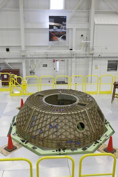 The upper dome of the Boeing CST-100 Structural Test Article awaits testing inside the Commercial Crew and Cargo Processing Facility, or C3PF, at NASA's Kennedy Space Center in Florida. The test article will serve as a pathfinder for assembling and processing operational CST-100 spacecraft inside the revitalized facility, which for 20 years served as a shuttle processing hangar. Photo credit: NASA/Kim Shiflett NASA image use policy.