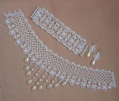 A bigger piece of lace and pearl or bead it for earrings. Would be pretty. Maybe even play with starch or glue on lace for stiffener to see the difference in how they hold up. Bead Crafts, Jewelry Crafts, Handmade Jewelry, Beading Projects, Beading Tutorials, Lace Jewelry, Bridal Jewelry, Jewellery, Beaded Lace