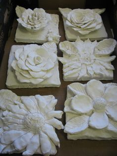 "4th grade ceramic flower sculptures; approx. 7""X 7"" per flower ; lesson designed by art teacher: Susan Joe"