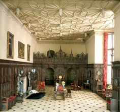 """Tudor Great Halls - The picture of Mrs. Thorne's """"Tudor Great Hall"""" room box shows what one might look like half-way  through the Tudor era. Great halls had undergone dramatic changes since Henry Tudor ascended to the throne as Henry VII kin 1485. It had been the most important room in a castle, but in the Tudor manor house, it would become obsolete."""