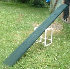 "Build Your Own Agility Course: Teeter Board. What you need: 8  1"" 90° elbows; 6  1"" T's; 4   2 ¼ ""  PVC; 4   5  1/2""  PVC; 9   12"" PVC; 1   10"" 1¼""pipe; 1 board 2x10; 2 plumbers straps 6"" long; Assorted screws; 1 piece Astroturf or indoor/outdoor carpeting to cover the board."