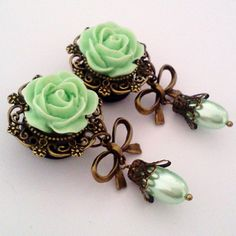 looks like a serving of chocolate chip mint icecream     mint Green Pearly Roses Dangly Plugs ($31)