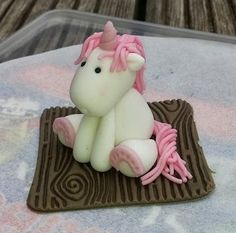 Unicorn sugarpaste cake topper - By DC Cakes and Bakes Ltd
