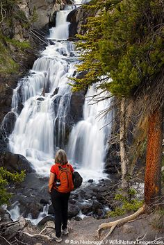 A hiker at Mystic Falls on the Mystic Falls Trail, Yellowstone National Park, Wyoming, US