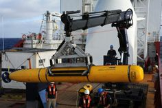 Operators aboard the Australian navy vessel ADF Ocean Shield move U.S. Navy's Bluefin-21 underwater drone into position for deployment on April 14, 2014, during a search for debris from Malaysia Airlines Flight 370. PETER D. BLAIR/U.S. NAVY