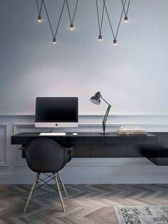 Arbeitsplatz mit Eames Chair und ausgefallener Beleuchtung