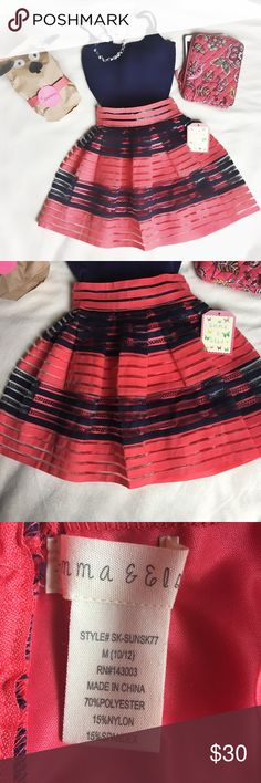 Emma & Elsa skirt Navy blue and coral skirt with gold zipped in the back. Coral lining. Lace and sheer mesh detail between stripes. Super cute and perfect for spring! Emma & Elsa Bottoms Skirts