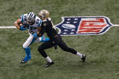 NEW ORLEANS, LA - DECEMBER 30: Greg Olsen #88 of the Carolina Panthers is tackled by Isa Abdul-Quddus #42 of the New Orleans Saints at the Mercedes-Benz Superdome on December 30, 2012 in New Orleans, Louisiana. (Photo by Chris Graythen/Getty Images)