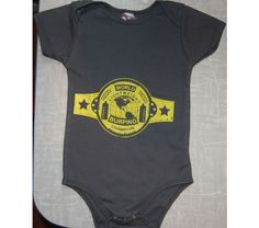 Forget boxing or wrestling, your baby is the burping champion of the world, and now has the belt to prove it.     Screenprinted gold ink on American Apparel fabric     Available in Men's and Women's design and colors (grey and purple).