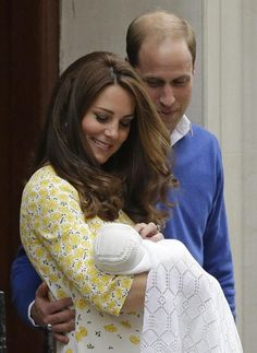 Britain's Prince William and Kate, Duchess of Cambridge look down at their newborn baby princess as they leave St. Mary's Hospital's exclusive Lindo Wing, London, Saturday, May 2, 2015.  Kate, the Duchess of Cambridge, gave birth to a baby girl on Saturday morning. (AP Photo/Matt Dunham)