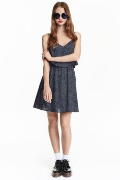 Sleeveless dress: Short dress in a viscose weave with adjustable shoulder straps, a wide flounce at the top, an elasticated seam at the waist and gently flared skirt.