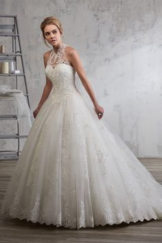 Wedding gown by Mary's Bridal.