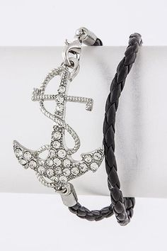 Silver-tone anchor with crystals on black faux leather band  * Not intended for children.  Do not chew or eat.