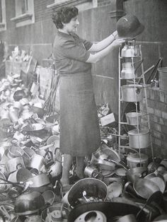 Collecting aluminum in 1940 for the war effort. Recycling them into materials used by our soldiers. The young,old,black,white,rich,poor,male or female-EVERYONE HELPED!