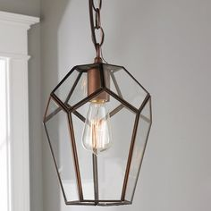 Darkened Copper Geometric Pendant This modern geometric pendant with Clear glass and Darkened Copper metal is both functional and on trend. Hang several above an island or a single one in a small foyer. Supplied with of chain, of cord and a round canopy. Copper Light Fixture, Copper Lighting, Cool Lighting, Pendant Lighting, Island Lighting, Light Fixtures, Glass Pendant Shades, Glass Pendant Light, Glass Pendants