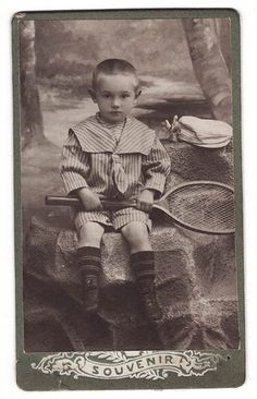 1910s Imperial Russia Little Boy in Fine Dress posing with Tennis Racket  .
