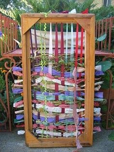 Make a giant rug loom out of an old wooden frame.