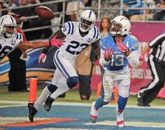 San Diego Chargers wide receiver Keenan Allen, right, makes a touchdown catch in the end zone as Indianapolis Colts cornerback Vontae Davis, center, and free safety Delano Howell