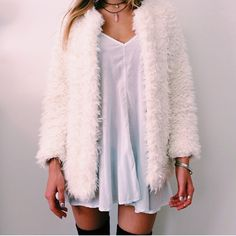 fuzzy cream sweater over white simple dress w over knee boots or socks
