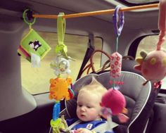 Create a toddler car activity center with a bungee cord! - then toys on your car seat won't void any warranties in case of an accident .