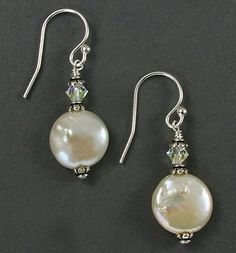 Sparkly Swarovski crystal beads complement the organic beauty of creamy coin shaped freshwater pearls. These classic pearl earrings can be...