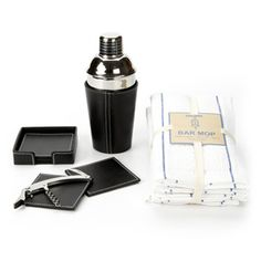 Even the most veteran mixologist will be impressed by this modern stainless steel martini shaker, handsomely paired with a white-stitched black leather cover, handsomely paired with a matching coaster set. $98.00