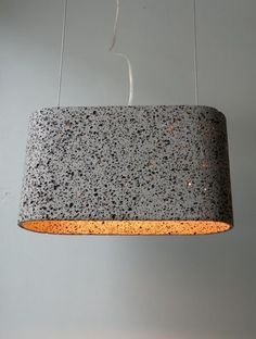 Terrazzo pendant. Innovative idea, lighting made with material normally used for flooring. The use of bright quartz works as a filter for the light, creating a nice effect.
