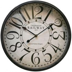 And dimension to any room with this oversized wall clock finished in antique-grey with a distressed white dial and bold stylized accent numeral