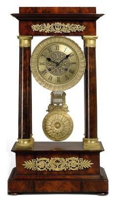 A FRENCH ORMOLU-MOUNTED MAHOGANY STRIKING PORTICO CLOCK - LATE 19TH CENTURY