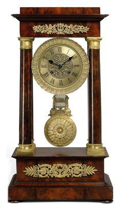 A FRENCH ORMOLU-MOUNTED MAHOGANY STRIKING PORTICO CLOCK - LATE 19TH CENTURY