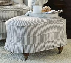 The Savannah ottoman from Pottery Barn. Oh so charming kick pleat and ticking fabric! For the red chair bottom pleats Monochromatic Room, Ticking Fabric, English Decor, Slipcovers For Chairs, Chair Fabric, Upholstered Furniture, My Living Room, Home Decor Bedroom, Home Decor Accessories