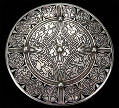 The Fuller Brooch is a piece of late 9th century Anglo-Saxon art of unknown provenance.  It is a large disc made of hammered sheet silver inlaid with black niello and with a diameter of 11.4 cm. Its centre roundel is decorated with personifications of the five senses. In the centre is Sight with large staring oval eyes, surrounded by the other four senses, each in his own compartment. Taste has a hand in his mouth. Smell's hands are behind his back, and he stands between two tal