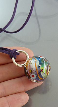 Hand Blown Glass Pendant |OOAK Jewelry | Lampwork Bead with Sterling Silver Bail and Leather Cord | By Melanie Moertel | Available on Etsy https://www.etsy.com/listing/227263783/colorful-hand-blown-glass-charm-round?ref=shop_home_active_2