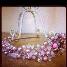 Alice style head band. Covered in Swarovski rose pearl, Swarovski crystal. Pale rose crystal and a beautiful pink flower bead. Designed by Devon Masters for The Button Room