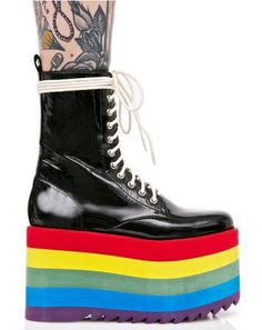 Current Mood Rainbow Stacked Platform! These super dope platform boots feature a sleek black patent vegan leather construction, sky-high, ultra lightweight platforms with rainbow stripes 'N treaded sole, and full length lace-ups.