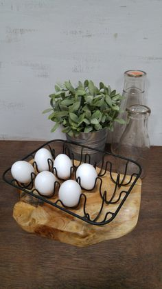 """This decorative wire egg holder holds 12 eggs. The wire tray can be bent to accommodate different sized eggs and could also be used to hold mini pots for seedlings. Details: 10 1/4"""" L x 7 1/2"""" W                                                                                                                                                                                 More"""