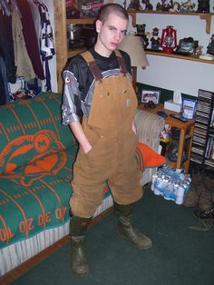 A double whammy of fashion No-No's: Overalls AND Rubber Boots.