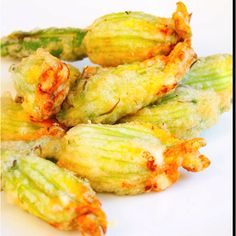 Herb and Cheese Stuffed-Fried Zucchini Blossoms - a gardener's delight! Cut off the male blossoms after they have opened and stuff them with your favorite herb/cheese mixture. Batter and fry tempura style. So good and they taste like zucchini!