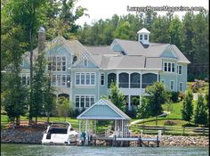 Amazing lake views from every room and custom detail throughout. Gourmet KIT w/Viking appliances, Master Bath w/over-sized shower, 2nd living quarters, home cinema, stone wine closet, Vantage lighting, 'lake KIT', 1800 sq. ft. garage & work area. Covered pier w/ lights, music, intercom to house,electric, water & 10,000  …