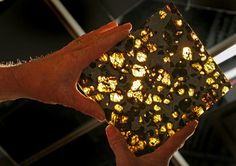 Fukang meteorite at Bonham's Auction house in New York City.   The object, found in Asia's Gobi desert in 2000, is thought to be as old as the solar system. Kilgore had hoped to fetch up to U.S. $2.7 million for the rock, but there were no takers. Instead a fossilized pile up of dinosaur feces stole the show, selling for nearly U.S. $1,000.