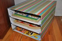 Puzzle storage: I stacked together three large Express Mail boxes using a glue stick. Then used glue stick to cover with wrapping paper.