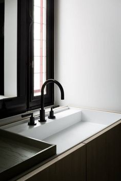 Black hardware. Interesting sink/counter design. Not sure what that tray is on the left but it might be good for us.