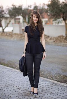 Love this black peplum top worn with black jeans. Chic!