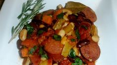 A great combination of beans, smoked sausage and vegetables in an easy one skillet meal. We've been making this so long I can't even remember where I first got the recipe. It's a staple when we go camping. My teenage daughter and her friends love it. Serve with a green salad and French bread.
