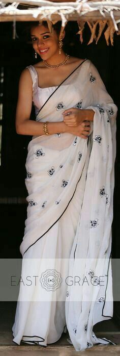 Milky white pure chiffon  embroidered saree.