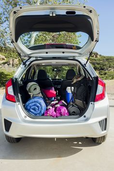 The Honda Fit is the perfect vehicle to bring on a camping trip—even if you choose not to sleep in it.  Honda reminds you to properly secure items in the cargo area.