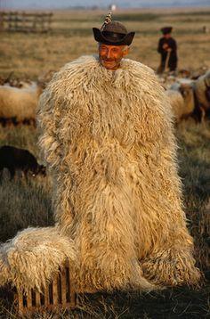A shepherd wears a coat known as a suba.  Location:Hortobagy National Park, Hortobagy Plain, Hungary.
