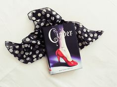 library-heaven:  October Book Photo Challenge Day 2: This book put a spell on me Cinder by Marissa Meyer I can't even begin to state how amazing this book is… I read the summary about tecnology and robots and bought it instantly.I didn't know what to expect going into it, but is was SO good!
